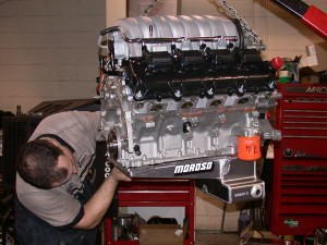 SpeedFactory technician Donald installs the Moroso 11qt drag pack oil pan.
